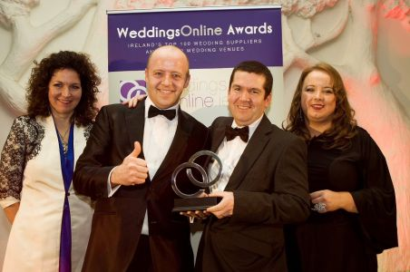 Harlequin receiving a wedding band award